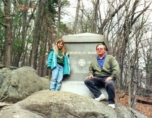 My daughter and me years ago on Little Round Top, checking out the memorial to the 20th Maine.